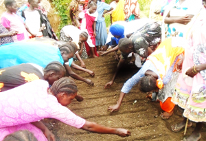 "Participants during practical's on sowing of seeds at Hai zira ""2"" vegetable group"