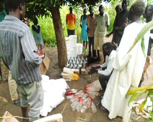Beneficiaries' during distribution of bee keeping equipment in mat-ku-rot group